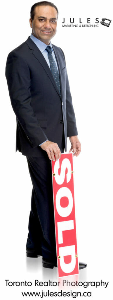 A realtor portrait with real estate sign
